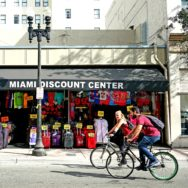 2 people on bicycles in a downtown Miami street