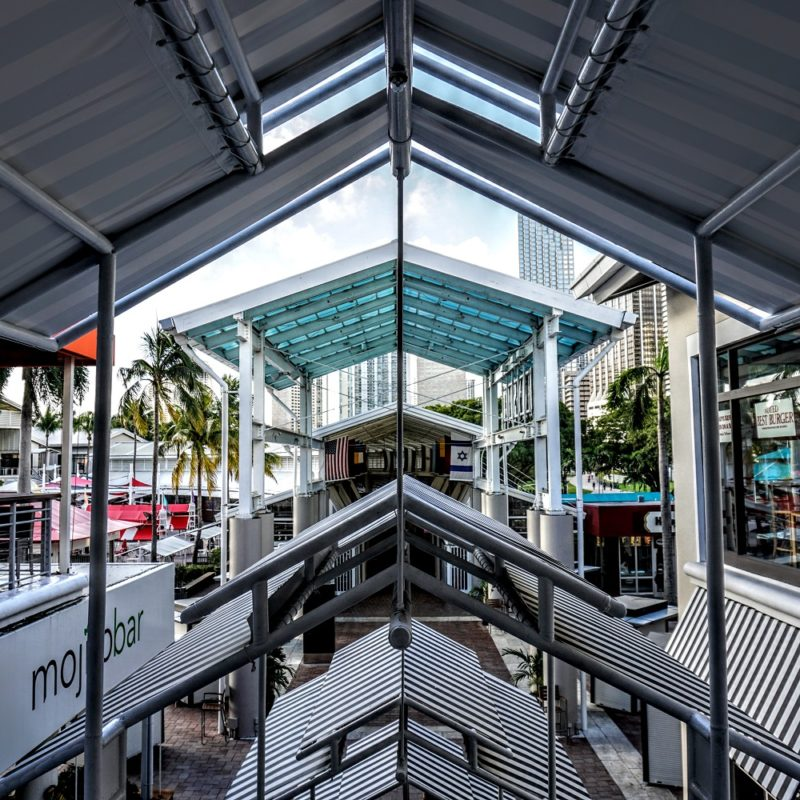 View from the top of the escalator showing the angles of the roof above, matching the walkway awnings below & the angles of the structure in front