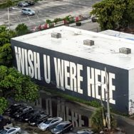 "Mural from Primary Project's ""Words Travel Fast"" series - Wish U Were Here"